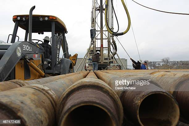 Workers drill for water for a farmer on February 6 2014 near Bakersfield California Now in its third straight year of unprecedented drought...