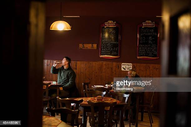 Workers drink beer in a local restaurant in a town under threat from the expansion of a nearby lignite coal mine in Horni Jiretin Czech Republic on...