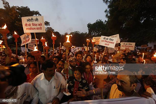 workers during a candle march against BJP Minister VK Singh over his remarks on the Faridabad Dalit burning incident at Jantar Mantar on October 25...