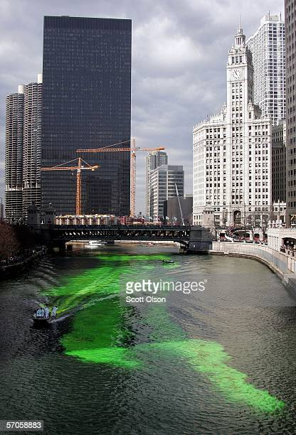 Workers dye a downtown section of the Chicago River green to begin the city's St Patrick's Day celebration March 11 2006 in Chicago Illinois The...