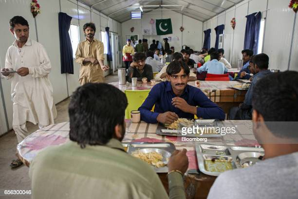 Workers eat at a canteen for Pakistani workers during a break at the Sindh Engro Coal Mining Co site in the Thar desert Pakistan on Wednesday March 8...