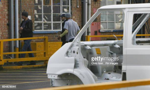 Workers enter Building B at the Ford factory in Southampton where workers have started a fourday week as the company cuts production in response to...