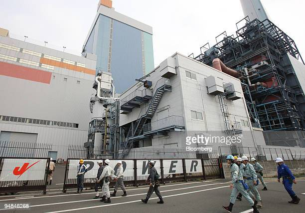 Workers enter Electric Power Development Co's Isogo power station in Yokohama City Japan on Monday April 28 2008 JPower said it won't be easy to win...