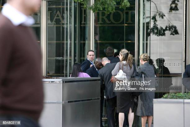 Workers enter the Lehman Brothers headquarters at Canary Wharf in London Lehman Brothers a top US investment bank has filed for bankruptcy