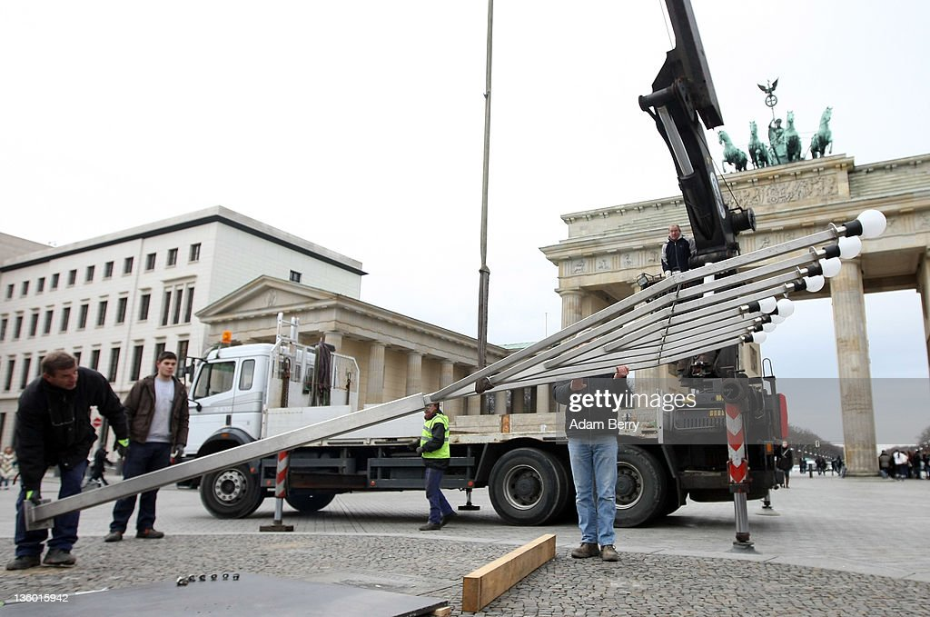Workers erect a large nine-armed candleholder, a Hannoukiah, or Menorah, ahead of the start of the eight-day-long and annual Jewish Festival of Lights known as Chanukah, in front of the Brandenburg Gate on December 20, 2011 in Berlin, Germany. The festival marks the rebellion of Maccabee Jews against the Greeks in 165 BC, which some believers say included a number of miracles pointing to divine providence.