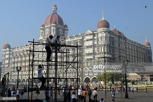 Workers erect a stage outside the iconic Taj Mahal Palace and hotel on the fifth anniversary of the 2008 attacks in Mumbai on November 26 2013 A...