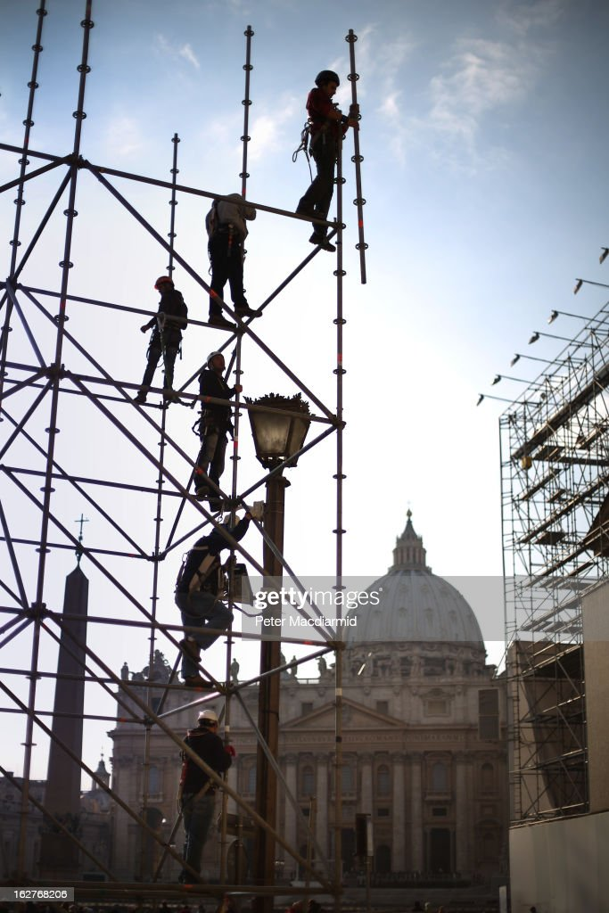Workers erect a stand for television cameras in sight of St Peter's Basilica on February 26, 2013 in Vatican City, Vatican. The Pontiff will hold his last weekly public audience on February 27, 2013 before he retires the following day. Pope Benedict XVI has been the leader of the Catholic Church for eight years and is the first Pope to retire since 1415. He cites ailing health as his reason for retirement and will spend the rest of his life in solitude away from public engagements
