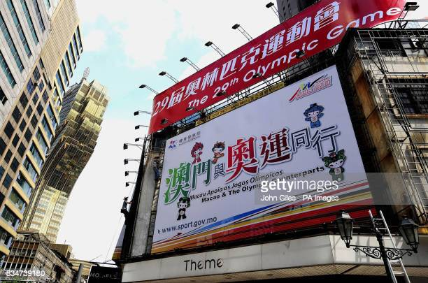 Workers erect giant posters for the Beijing Olympics today in Macau City one week ahead of the start of the Olympics Macau China