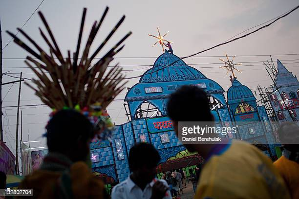 Workers erect lights on the top of a theatre where people pay to watch women dance during the Sonepur Mela on November 14 2011 in Sonepur near Patna...