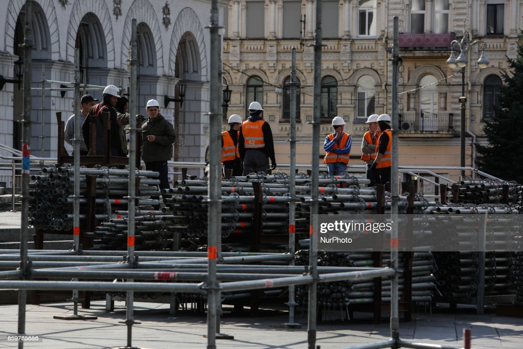 Workers erect the stage constructions at Independence square in Kyiv, October 10, 2017.