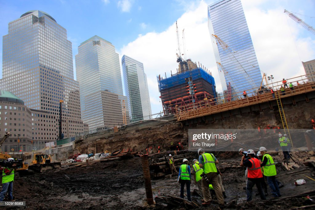 Workers examine remnants of what is thought to be an 18th century ship at the site Ground Zero Construction Site in July 15, 2010 New York City. The wood hulled vessel is approximately 30 feet long and was found 20 to 30 feet below street level on Tuesday morning.