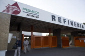 Workers exit the main gate at the Petroleos Mexicanos Miguel Hidalgo Refinery in Tula de Allende Mexico on Thursday March 6 2014 The Pemex board of...