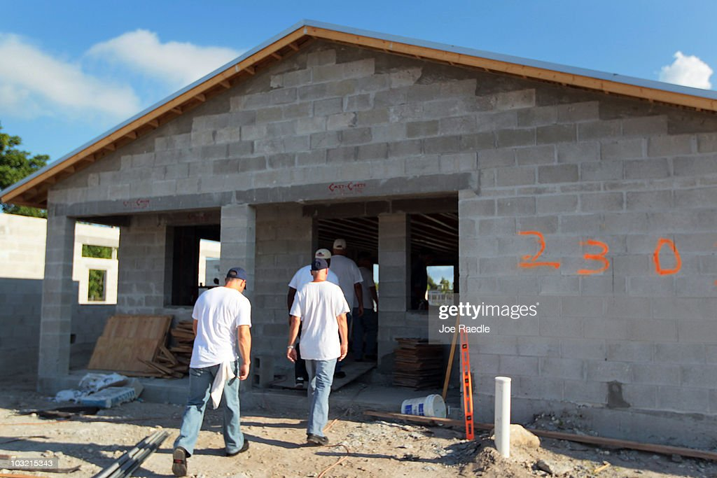 Workers file into a Habitat for Humanity home they are building on August 3, 2010 in Fort Lauderdale, Florida. In July, Habitat for Humanity was named the eighth largest homebuilder in the United States by Builder's Magazine, the first time the nonprofit has been among the top 10 biggest builders in the United States.