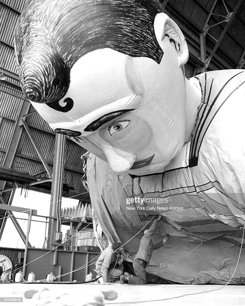 Workers fill Superman with helium for Macy's Thanksgiving Day parade.