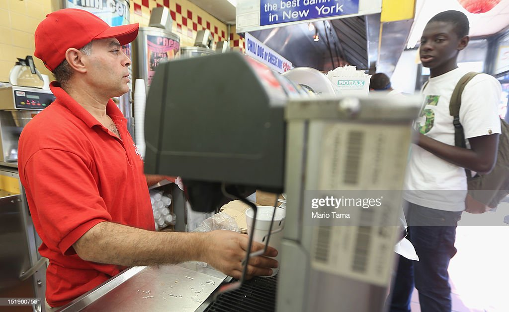 A workers fills a cup with soda at a Manhattan fast food restaurant on September 13, 2012 in New York City. In an effort to combat obesity, the New York City Board of Health voted to ban the sale of large sugary drinks. The controversial measure bars the sale of sugar drinks larger than 16 ounces at restaurants and concessions.