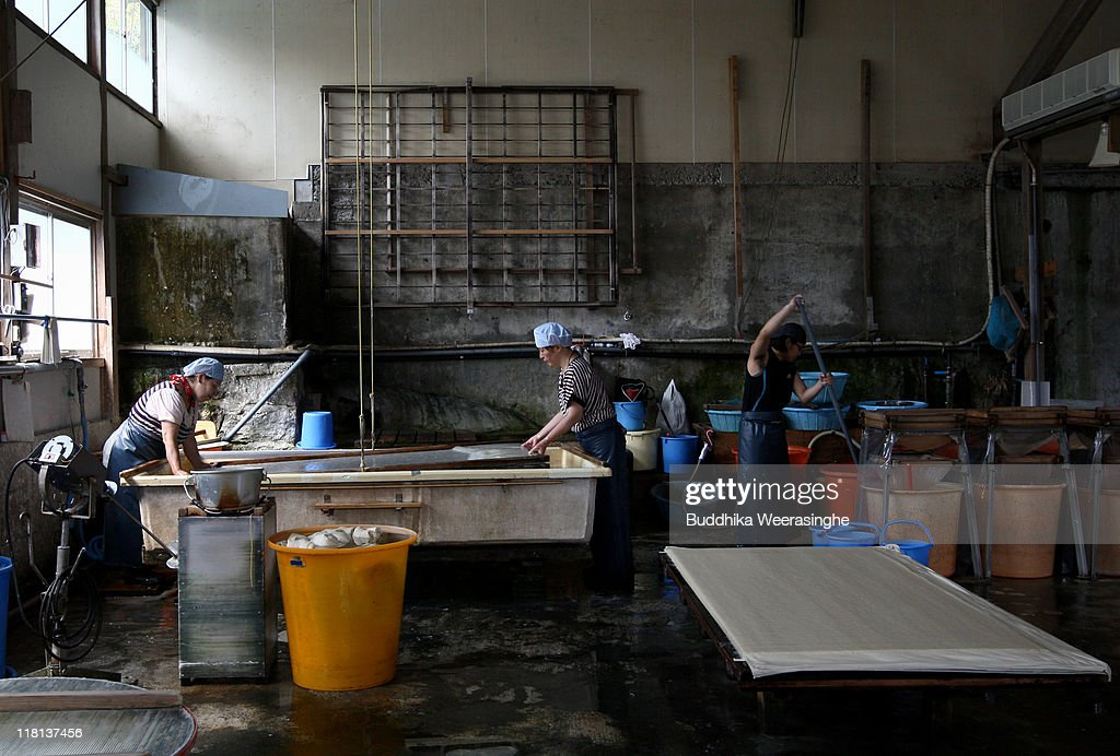 Workers filter pulp at a mill that produces handmade paper at Iwano Heizaburo Seishi Sho Company in Echizen paper village on July 4, 2011 in Fukui, Japan. Washi paper is a tough paper, used for traditional Japanese arts such as Origami and Shodo, most commonly made from bark of the mulberry, gampi or mitsumata. The paper milling process is a traditional craft of the Echizen people dating back 1500 years which continues today along with modern paper manufacturing. Echizen city is home to many paper businesses, as well as the cultural museum of paper and papyrus centre where visitors can make their own paper.