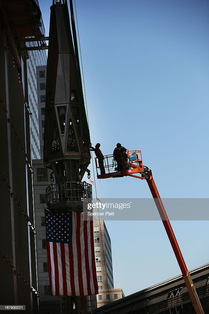 Workers fit supports to the final two sections of the last 75-foot section of the 408-foot spire that will be hoisted to a temporary platform on the top of One World Trade Center on May 2, 2013 in New York City. When bolted into place at a later date, the spire will make One World Trade Center the tallest building in the Western Hemisphere.The raising of the spire, which comes on the second anniversary of the death of Osama bin Laden, will make One World Trade Center 1,776 feet tall. One World Trade Center is built on the site where the September 11, 2001 attacks toppled the original World Trade Center towers.