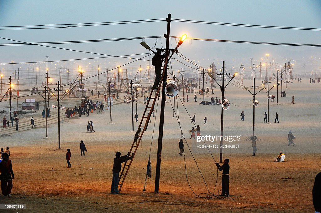 Workers fix a lightpost, one of many that will illuminate the vast grounds receiving the millions of Hindu devotees that will congregate here for the next couple of months to celebrate the Kumbh Mela, in Allahabad on January 13, 2013. Worshippers, believe a dip in the holy waters cleanses them of their sins. The Kumbh Mela in northern India, starting on January 14 and stretching over 55 days, attracts ash-covered holy men who run into the frigid waters, a smattering of international celebrities, as well as millions upon millions of ordinary Indians to Allahabad.