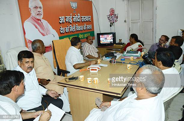 BJP workers following Bihar assembly bypolls results at party office on August 25 2014 in Patna India RJDJDUCongress alliance won six while BJP won 4...