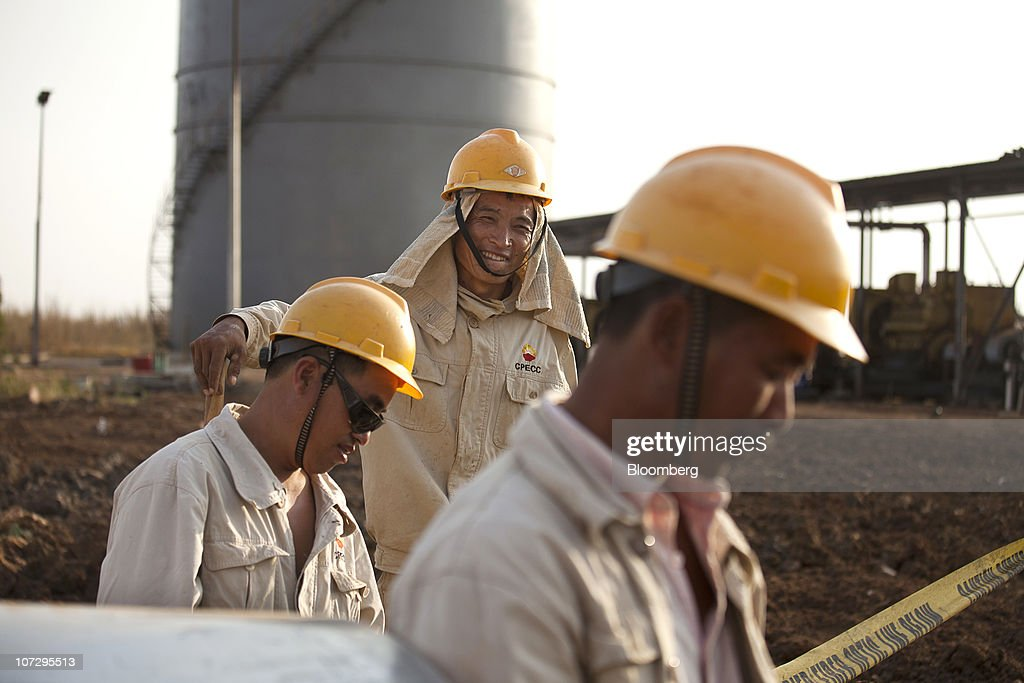 Workers for the China Petroleum Engineering Construction Corp construct new oil facilities near Melut in the Upper Nile Sudan on Monday Nov 29 2010...
