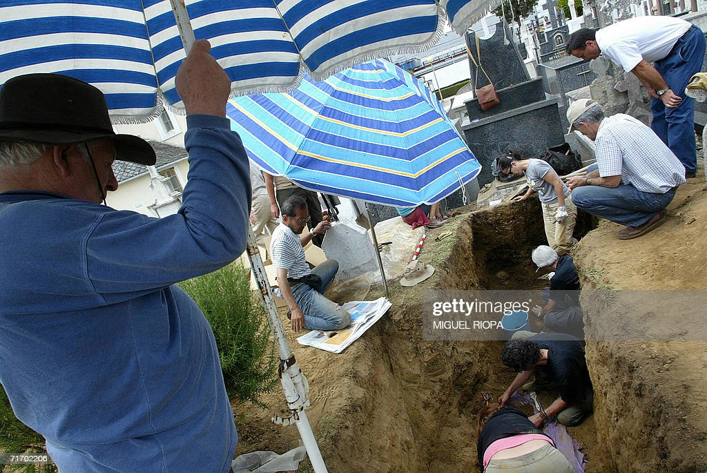 Workers for the Spanish organisation Association for the Recuperation of Historic Memory exhume the remains of four bodies of the same family...