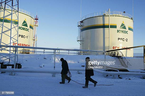 Workers from contractors company of YUKOS giant oil company build at a new pumping station November 10 2004 on the UstBalick oil field near...