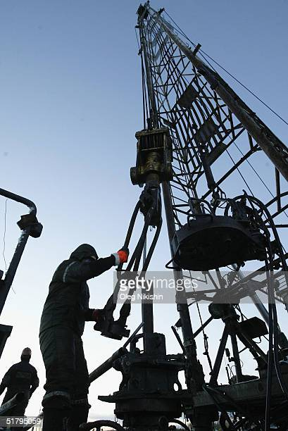 SSC workers from contractors company of YUKOS giant oil company servicing an oil well November 10 2004 on the Ust Balick oil field near Nefteyugansk...