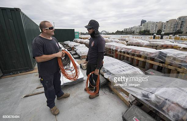 Workers from Foti International fireworks attend to fireworks on barges on December 29 2016 in Sydney Australia Sydney's New Year's Eve fireworks...