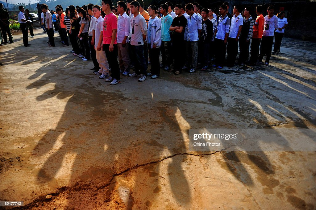 Workers from Henan Province line up to register at the Shenzhen Quanshun Human Resources Co. Ltd. on February 26, 2009 in Shenzhen, Guangdong Province, China. The company, which was established by entrepreneur Zhang Quanshou, supplies workers to enterprises in the Guangdong and Fujian provinces. Since 1997 Zhang has recruited migrant workers and leased them to factories, once the production order of a company is finished workers are then transferred to another one.