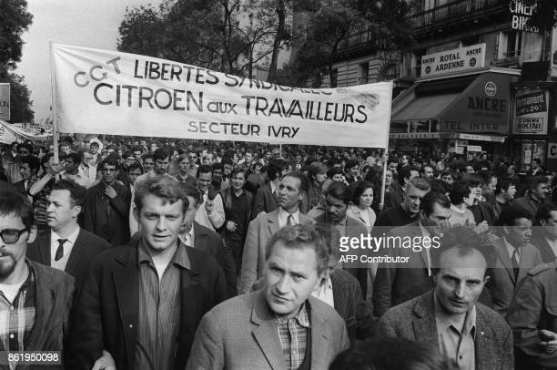 Workers from the Citroen car factory take part to a big demonstration called by the CGT and CFDT unions in Paris 29 May 1968 during the May 1968...