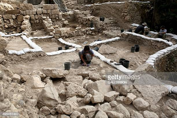 Workers from the Israeli Antiquity Authorities dig on November 3 2015 at the excavation site near the City of David adjacent to Jerusalem's Old City...