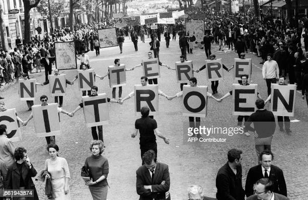 Workers from the Nanterre Citroen car factory take part in the big unitarian demonstration organized by the French workers unions CGT 29 May 1968 at...