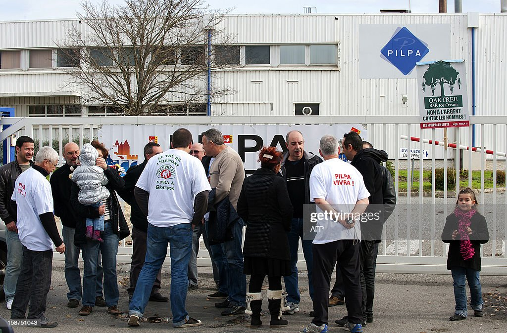 Workers from the Pilpa ice cream factory in Carcassonne, southern France, take part in surveillance rounds to stop the new factory owner from taking or dismantling factory equipment and machines, on December 27, 2012. 112 workers face the threat of being layed-off since July 2012 when the factory's owner sold the site to the R&R ice cream company and have struggled to keep the site and its jobs ever since. As the workers await court rulings pertaining to the factory site and its future, workers say they are being vigilant and have instituted rounds and a night guard to make sure R&R does not leave with the machines and equipment, thereby making it impossible for workers to consider continuing production at the site. AFP PHOTO / REMY GABALDA