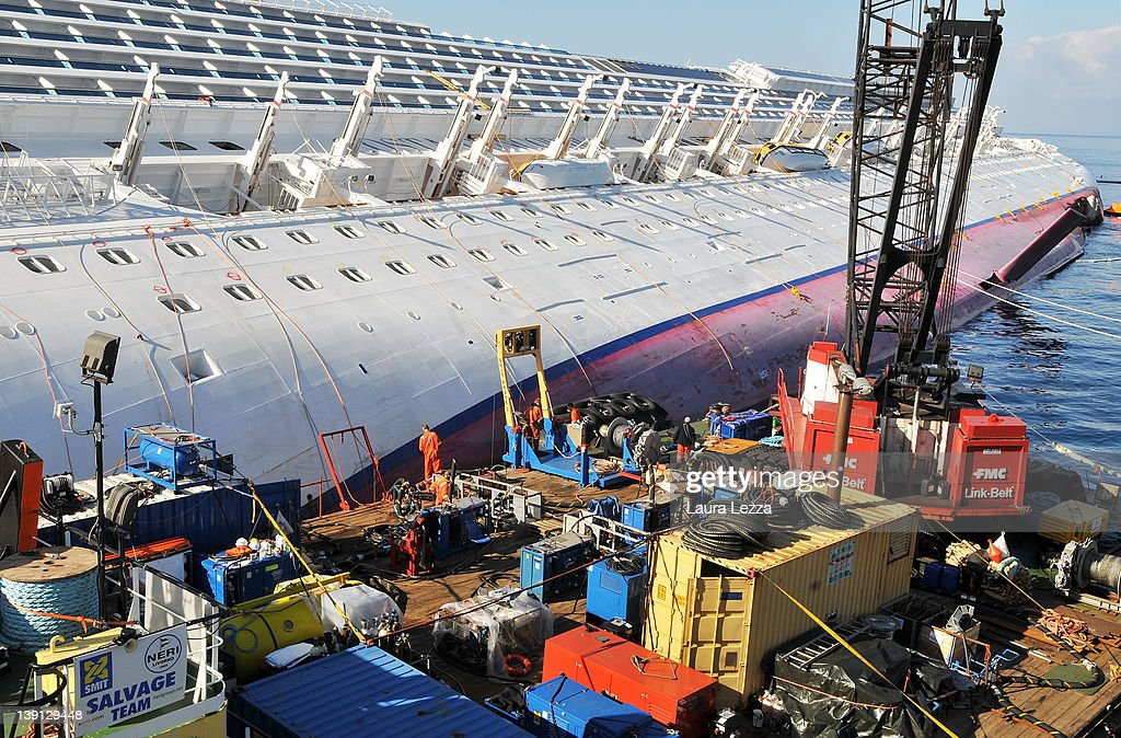 Workers from the Rotterdam based SMIT salvage firm work from a pontoon while taking part in the operation to remove fuel from the cruise ship Costa...
