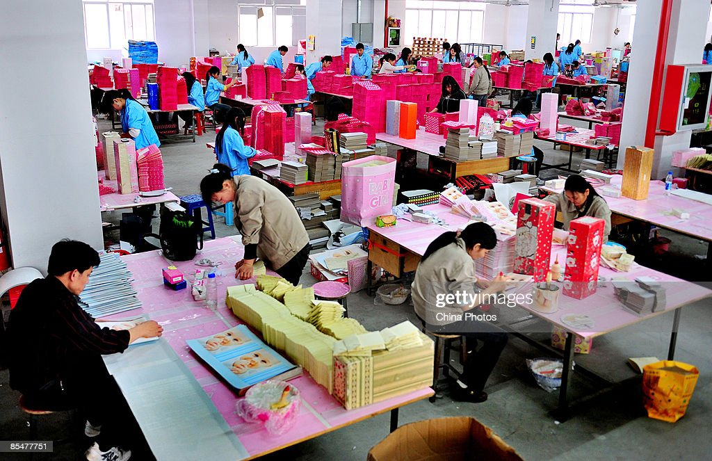 Workers from the Shenzhen Quanshun Human Resources Co. Ltd. (in blue clothes) work at the Pinghu Paper Factory on March 9, 2009 in Shenzhen, Guangdong Province, China. The company, which was established by entrepreneur Zhang Quanshou, supplies workers to enterprises in the Guangdong and Fujian provinces. Since 1997 Zhang has recruited migrant workers and leased them to factories, once the production order of a company is finished workers are then transferred to another one.