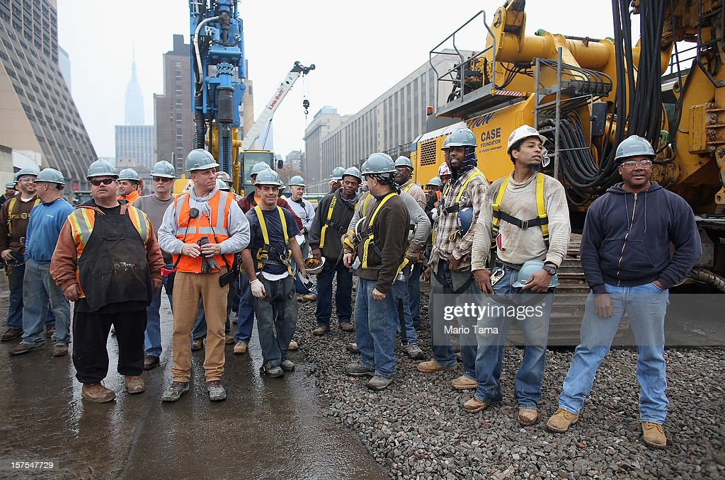 Workers gather at a groundbreaking ceremony for the Hudson Yards development at the site which is expected to boast 13 million square feet of residential and commercial space on a 26-acre site on Manhattan's west side on December 4, 2012 in New York City. The site was the largest undeveloped piece of property in Manhattan and is expected to create around 23,000 construction jobs. It will be the largest private development in the city since Rockefeller Center.