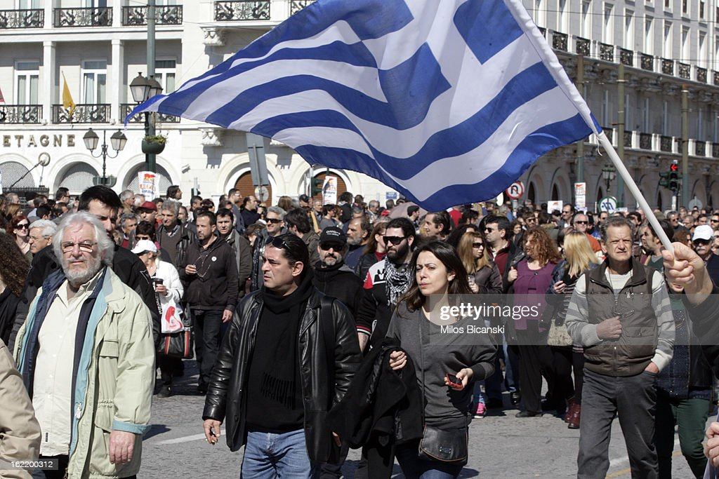 Workers gather outside Greece's parliament during a protest on February 20, 2013 in Athens, Greece. Unions have launched general strike against austerity measures in Greece, amid predictions unemployment in the crisis-hit country will reach 30 percent this year.
