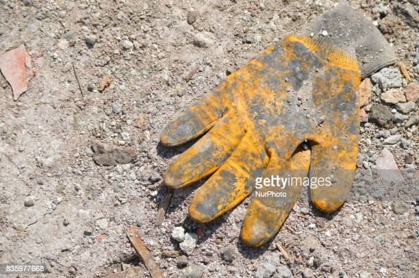 A worker's glove can be seen on the floor at a construction site in the Anayurt neighbourhood of Ankara Turkey on August 20 2017