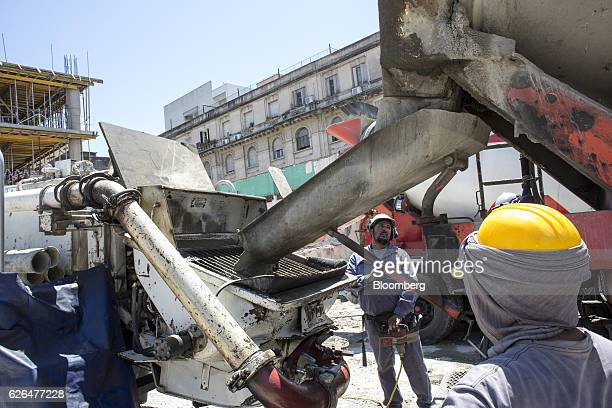 Workers guide a concrete mixer inside the construction site for the Hornos 330 Master Office 3 building development in Buenos Aires Argentina on...