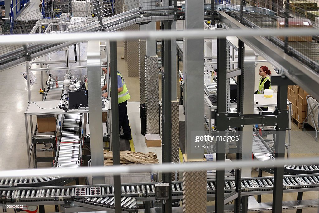 Workers handle items in the giant semi-automated distribution centre where the company's partners process the online orders for the John Lewis department store on January 3, 2013 in Milton Keynes, England. John Lewis has published their sales report for the five weeks prior December 29, 2012 which showed online sales had increased by 44.3 per cent over the same period in 2011. Purchases from their website Johnlewis.com now account for one quarter of all John Lewis business.