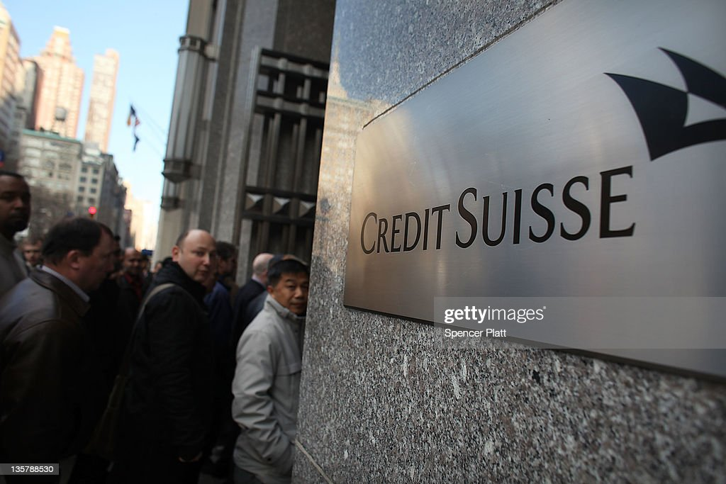 Workers head back into the Credit Suisse headquarters following a suspicious package that arrived in the mail on December 14 2011 in New York City...