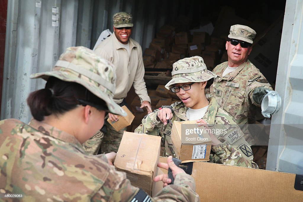 Workers help to fill a pallet with excess electrical connectors left by a departing unit as the U.S. continues draws down manpower in the 13-year-old war on March 22, 2014 near Gardez, Afghanistan. The connectors are slated to be sold for scrap. In the past year the U.S. Military has been reducing troops and equipment in Afghanistan as it transitions from a role of combatants, fighting alongside Afghan soldiers, to assisting the Afghan National Security Forces in an advisory role. President Obama recently ordered the Pentagon to develop a contingency plan for a complete pullout from Afghanistan by the end of 2014 if Afghanistan President Hamid Karzai or his successor refuses to sign the Bilateral Security Agreement.