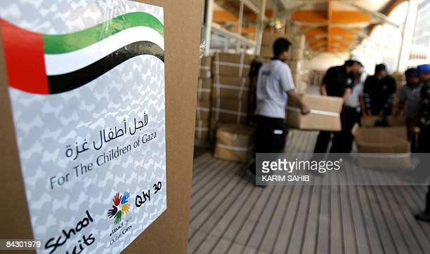 Workers helping the Emirati charity initiative 'Dubai Cares' for Gaza load aid destined for the beleaguered Gaza Strip in Dubai on January 15 2009...