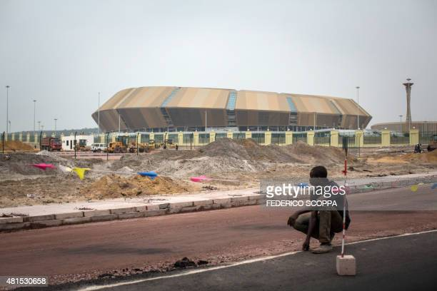 A workers helps with the construction of the Kintele Stadium site near to Brazzaville on July 22 2015 Brazzaville will host the 11th edition of the...