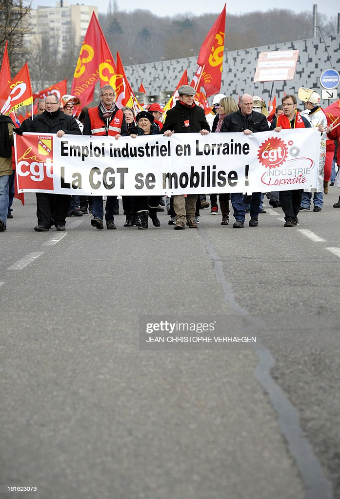 Workers hold a banner reading 'Industrial jobs in Lorraine, CGT trade union is committed', during a demonstration called by French CGT trade union on February 13, 2013 in Metz, eastern France, to claim for the safeguard of the local industry in the French eastern region of Lorraine.
