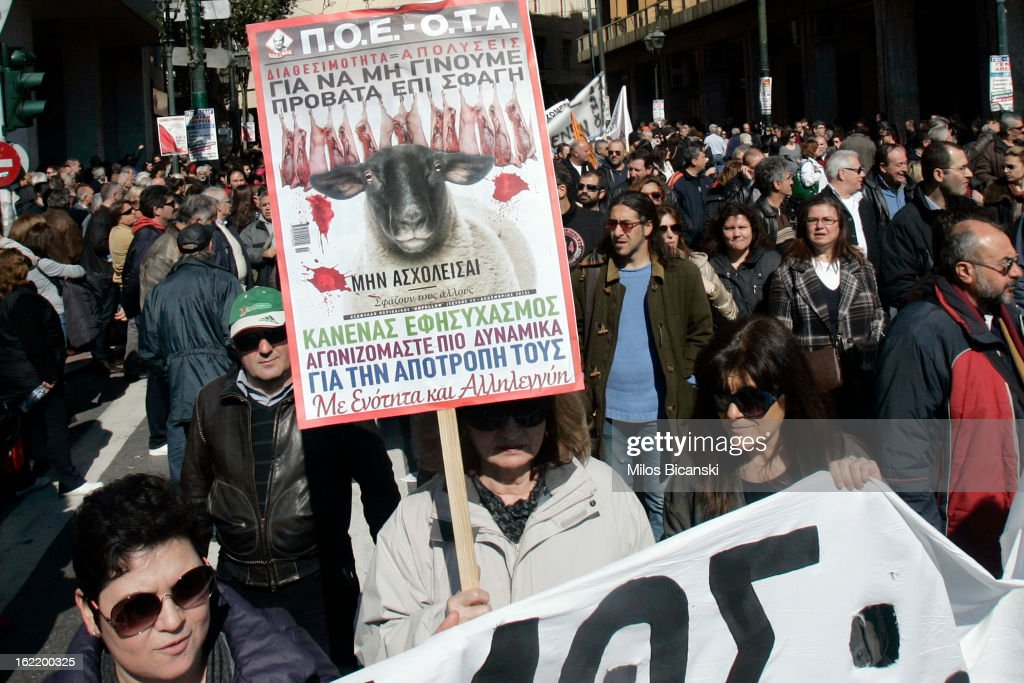 Workers hold a banner saying 'We are not ship for food' during a protest on February 20, 2013 in Athens, Greece. Unions have launched general strike against austerity measures in Greece, amid predictions unemployment in the crisis-hit country will reach 30 percent this year.