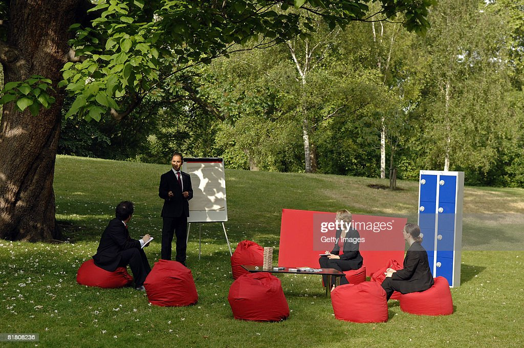 Workers Hold A Meeting At The Visit London Outdoor Office In St Jamesu0027 Park  On