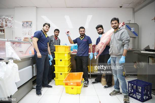 Workers in a butchery in the southwestern suburb of Lakemba pose for a photograph on May 27 2017 in Sydney Australia Muslims around the world mark...