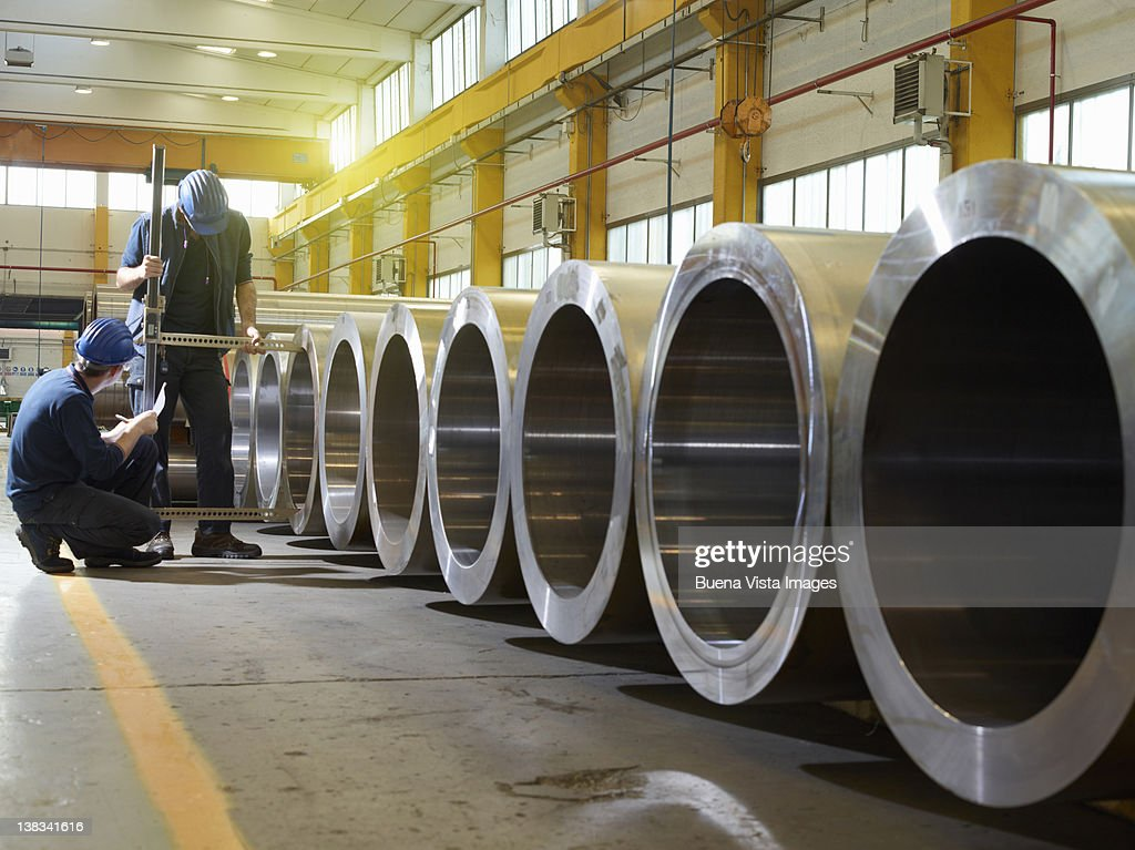 Workers in a steel factory : Stock Photo