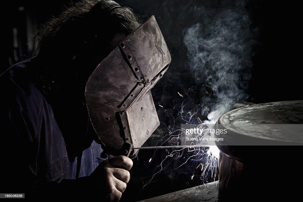Workers in a steel factory welding